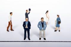 Gente miniatura en las personas Imagen de archivo