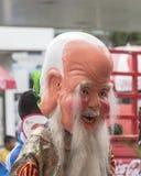 Gente no identificada con la máscara y traje en el desfile en el festival del Año Nuevo chino y del vegetariano Fotografía de archivo libre de regalías