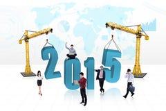 Gente ocupada con el número 2015 Foto de archivo libre de regalías