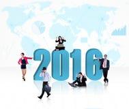 Gente ocupada con los números 2016 Imagen de archivo libre de regalías