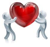 Gente que lleva a cabo el corazón gigante Imagen de archivo libre de regalías