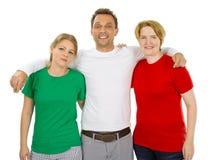 Gente que lleva las camisas en blanco blancas y rojas verdes Imagen de archivo libre de regalías