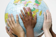 Gente que soporta un globo Imagen de archivo libre de regalías