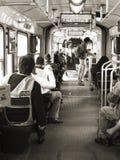 Gente que viaja dentro de una tranvía Imagen de archivo