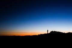 Gente sola en oscuridad Fotografía de archivo libre de regalías