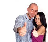 gente sorridente con il pollice in su Fotografie Stock Libere da Diritti