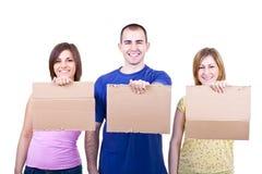 Gente sorridente con la scheda in bianco Fotografie Stock