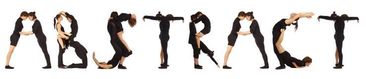 Gente vestida negro que forma palabra ABSTRACTA imágenes de archivo libres de regalías