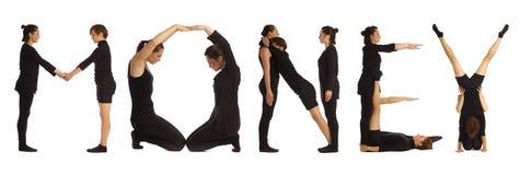 Gente vestida negro que forma palabra del DINERO fotografía de archivo