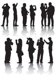 Gente y cámara de los fotógrafos Imagen de archivo libre de regalías