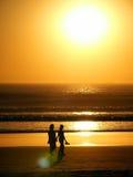 Gente y puesta del sol Foto de archivo libre de regalías