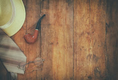 Gentelman accessories on wooden background. Top view. vintage filtered image stock image