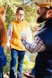Gentil garçon joyeux écoutant son professeur de biologie images libres de droits
