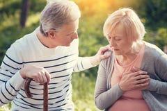 Gentil homme de soin regardant son épouse Photographie stock libre de droits