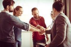 Gentille équipe heureuse étant prête à travailler Photographie stock