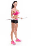 Gentille femme sexy faisant la séance d'entraînement avec la grande haltère, retouchée Images stock