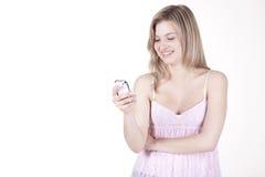 Gentille fille avec le téléphone portable Photos stock