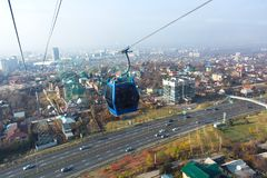 Genting highland cable car. Aerial tramway moving up under the city Stock Images
