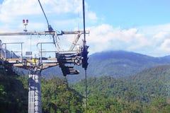 GENTING-HOCHLÄNDER, MALAYSIA - 21. DEZEMBER: Touristen reisen auf Drahtseilbahn von Genting Skyway Es ist eine Gondelbahn, die Go stockbilder