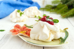 Gentle Air dessert `Anna Pavlova` with raspberries, whipped cream on a light background. Close-up Royalty Free Stock Photos