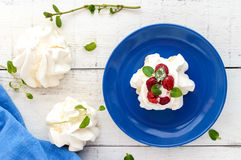 Gentle Air dessert `Anna Pavlova` with raspberries, whipped cream on a light background. The top view Royalty Free Stock Images