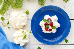 Gentle Air dessert `Anna Pavlova` with raspberries, whipped cream on a light background. The top view Stock Photo