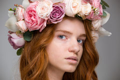 Gentle beautiful girl with red hair in wreath of roses Stock Photos