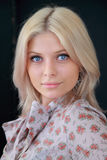 The gentle blonde with blue eyes. And a charming smile royalty free stock photos
