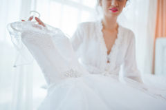 Gentle blonde  bride on couch Stock Photos