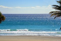 Gentle blue waves bring a colorful beauty to the Boca Raton Be. The South Florida Coastline offers many fine beaches with Boca Raton ranking high on any list Royalty Free Stock Photography