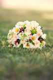 Gentle bridal bouquet on a grass Stock Photo