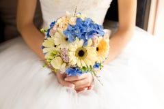 Gentle bridal bouquet in hands Stock Image