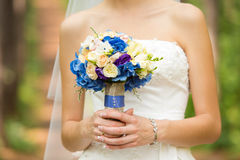 Gentle bridal bouquet in hands. Bridal bouquet of blue color in hands Royalty Free Stock Photos