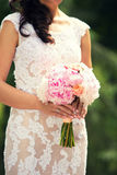 Gentle bridal bouquet in hands. Bridal bouquet of pink color in hands Stock Photography