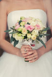 Gentle bridal bouquet in hands Stock Photos