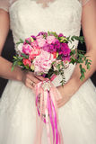 Gentle bridal bouquet in hands. Bridal bouquet of pink color in hands Royalty Free Stock Photos