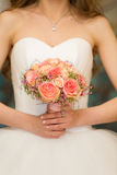 Gentle bridal bouquet in hands Royalty Free Stock Photo