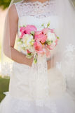 Gentle bridal bouquet in hands Royalty Free Stock Images