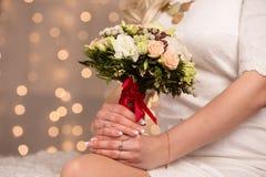 Gentle bridal bouquet in hands Stock Images