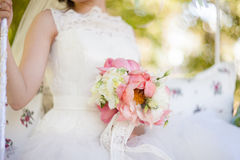 Gentle bridal bouquet in hands. Bridal bouquet of pink color in hands Royalty Free Stock Photography