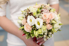 Gentle bridal bouquet in hands. Bridal bouquet of pink color in hands Stock Photo