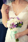 Gentle bridal bouquet in hands. Bridal bouquet of violet color in hands Stock Photography