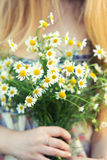 Gentle bridal bouquet in hands. Bridal bouquet of yellow color in hands Royalty Free Stock Image