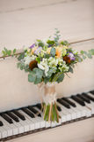 Gentle bridal bouquet. On a piano in the light room Stock Images