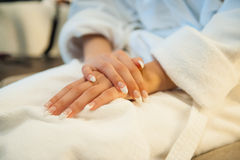 Gentle bride in a dressing gown waiting for meet Royalty Free Stock Photography