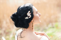 The gentle bride with flowers in a hairstyle Royalty Free Stock Images