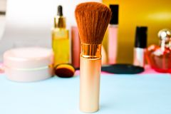 Gentle brush of natural lint for applying powder on the background of a cosmetic table for makeup for beauty guidance royalty free stock photo