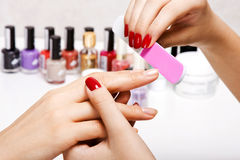Gentle care of nails in a beauty salon Stock Images