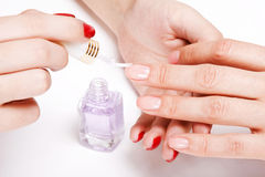 Gentle care of nails in a beauty salon Royalty Free Stock Image