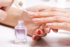 Gentle care of nails in a beauty salon Royalty Free Stock Photos